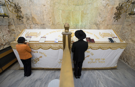 israelite: JERUSALEM, ISRAEL - 08 OCTOBER, 2014: Left the section for woman, right the section for man to pray at The tomb of King David which is located in a corner of a room  on Mount Zion in Jerusalem
