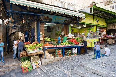 palestinian: JERUSALEM, ISRAEL - OCT 08, 2014: Fruit  shop in the small streets of the muslim quarter near Damascus gate in the old city of Jerusalem Editorial