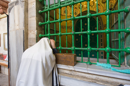 leah: HEBRON, ISRAEL, 10 OCT, 2014: A jewish man is praying in front of the tomb of patriarch Abraham. The tombs of the patriarchs are situated in the Cave of Machpelah in Hebron Editorial