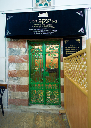 leah: HEBRON, ISRAEL, 10 OCT, 2014: Behind the green iron door is the tomb of patriarch Jacob. The tombs of the patriarchs are situated in the Cave of Machpelah in Hebron Editorial
