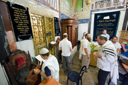 leah: HEBRON, ISRAEL, 10 OCT, 2014: Jews are celebrating sukkot in front of the The tomb of Sarah, wife of patriarch Abraham. The tombs of the patriarchs are situated in the Cave of Machpelah in Hebron
