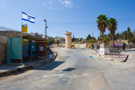 HEBRON, ISRAEL - 10 OCT,  2014: Deserted street with watchtower in the jewish quarter near the center of Hebron Stock Photo - 36942208