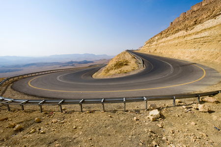 A hairpin bend on a road in the mountains of the negev desert in Israel photo