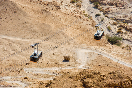 masada: Cable cars that brings people up to the top of Masada in Israel.