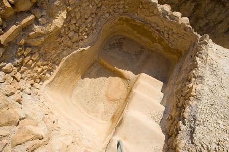 masada: Steps leading into a bath pool in Masada in Israel
