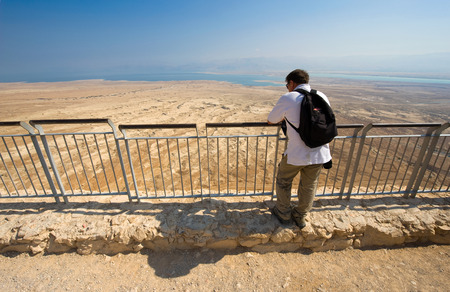 MASADA, ISRAEL - OCT 14, 2014: Tourist enjoying the view from Masada