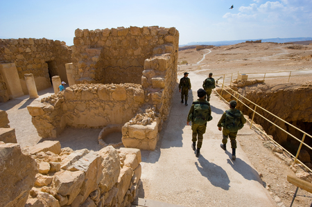 ancient israel: Soldiers are patrolling for security on masada in Israel Editorial