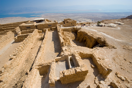 Ruins on top of the rock Masada in Israel photo