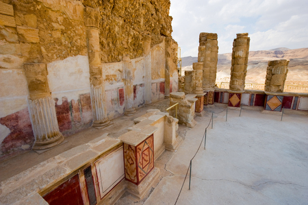 Pilasters and columns, plastered and painted with frescos at the lower terrace of the palace of king Herod on the rock masada