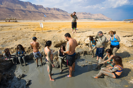 dead sea: DEAD SEA, ISRAEL - OCT 13, 2014: People rub with mud on the beach of the dead sea in Israel