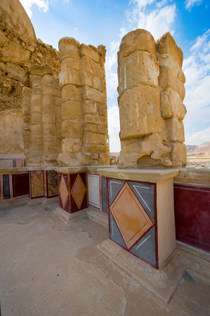 pilasters: Pilasters and columns, plastered with painted frescos at the lower terrace of the palace of king Herod on the rock masada Editorial
