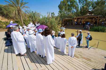 baptize: YERICHO, ISRAEL - OCT 15, 2014: A religious group christians during a baptism ritual at Qasr el Yahud near Yericho on the Jordan river Editorial