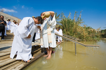 judea: YERICHO, ISRAEL - OCT 15, 2014: A christian woman is being baptized by water during a baptism ritual at Qasr el Yahud near Yericho on the Jordan river
