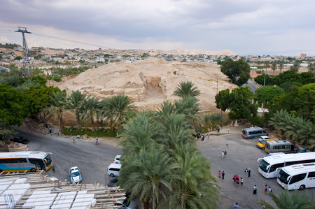 jewish town: JERICHO, ISRAEL - OCT 15, 2014: Tourists visiting the oldest city in the world Jericho also called Tell es-Sultan. The mound is 21 metres high and covers an area of about one acre.