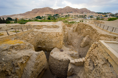 Old ruins and remains in Tell es-Sultan better known as Jericho the oldest city in the world, with the mount of temptation on the background.