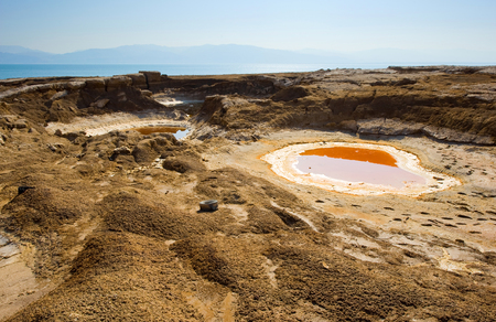 open pit: Sinkhole or open pit on the shore