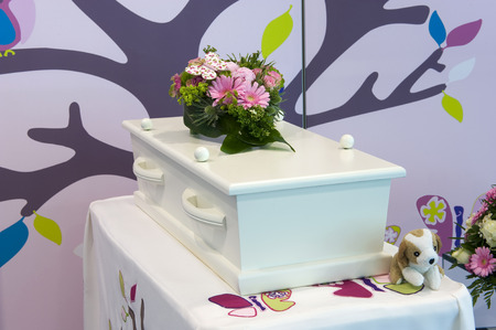undertaker: A small coffin for a child in in mortuary Stock Photo