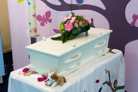 A coffin for a kid in a mortuary Stock Photo
