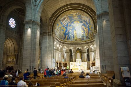 paris france: PARIS, FRANCE - JULY 27, 2015: Tourists are visiting and praying in the sacre coeur cathedral in Montmarte in Paris in France