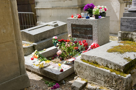 burial: PARIS, FRANCE - JULY 27, 2015: Grave of singer and rock star Jim Morrison on cemetery Pere Lachaise in Paris in France. Its one of the most visited graves by tourists and fans on this cemetery