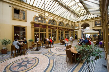 french cafe: PARIS, FRANCE - JULY 27, 2015: Galerie Vivienne is an ancient historical shopping passage with shops, cafes, and restaurants. Its one of the tourist attractions in Paris in France Editorial