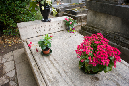 celebrity: PARIS, FRANCE - JULY 27, 2015: Grave or actors couple Simone Signoret and Yves Montand on Pere Lachaise cemetery in Paris in France. Editorial