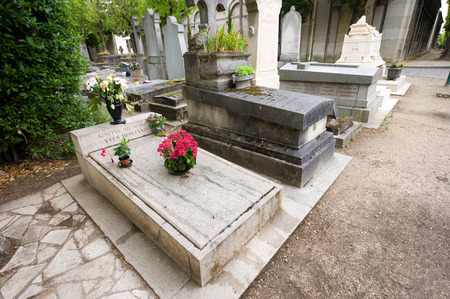 rigid: PARIS, FRANCE - JULY 27, 2015: Grave of actors couple Simone Signoret and Yves Montand on cemetery Pere Lachaise in Paris in France.