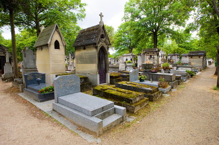 residual: PARIS, FRANCE - JULY 27, 2015: Graves and monuments in Pere Lachaise cemetery in Paris in France, a lot of famous people are buried here