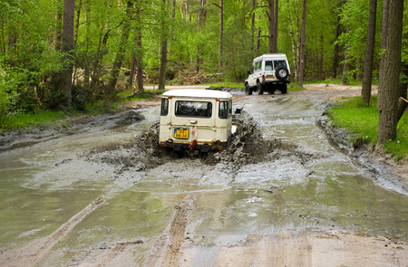 4x4: FURSTENAU, GERMANY - MAY 09, 2015: A jeep is driving through a pond of water on a special off the road terrain for land cruisers and vehicles in Germany