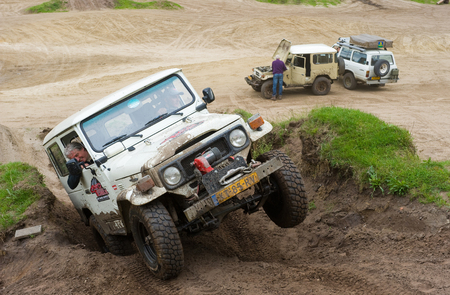 jeep: FURSTENAU, GERMANY - MAY 09, 2015: A Toyota 4-wheel drive is driving on a special off the road terrain for land cruisers and vehicles in Germany Editorial