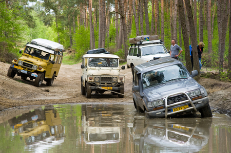 4wd: FURSTENAU, GERMANY - MAY 09, 2015: A Toyota Land Cruiser is stuck in a pond of water on a special off the road terrain for land cruisers and vehicles in Germany Editorial