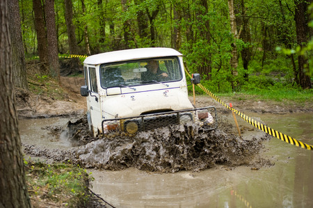jeep: FURSTENAU, GERMANY - MAY 09, 2015: A jeep is driving through a pond of water on a special off the road terrain for land cruisers and vehicles in Germany
