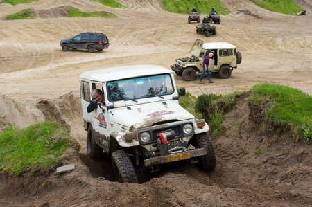 rallying: FURSTENAU, GERMANY - MAY 09, 2015: A Toyota 4-wheel drive is driving on a special off the road terrain for land cruisers and vehicles in Germany Editorial