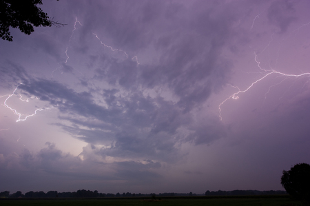 thundering: Thunder and lightning at the end of a hot and moistly summer day in the Netherlands