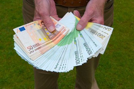 banknotes: A man wich euro banknotes in his hand