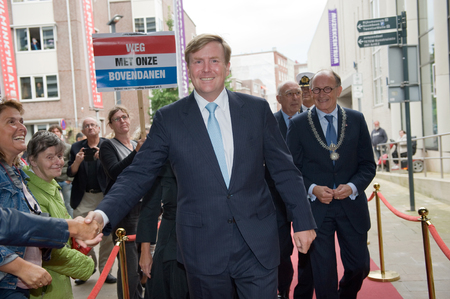 orange nassau: ENSCHEDE, THE NETHERLANDS - SEPT 03, 2015: King Willem Alexander from The Netherlands is shaking hands with people while he is going to visit a performance in a theater