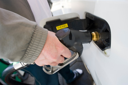 octane: A man is filling the tank of his car with diesel Stock Photo