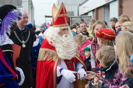 nicolas: ENSCHEDE, THE NETHERLANDS - NOV 14, 2015: The dutch Santa Claus called Sinterklaas is greeting the children after he has arrived on a boat in a dutch harbor