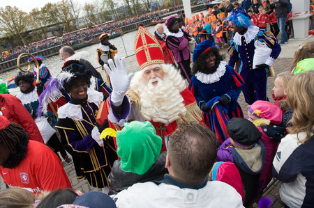 ENSCHEDE, THE NETHERLANDS - NOV 14, 2015: The dutch Santa Claus called Sinterklaas is greeting the children after he has arrived on a boat in a dutch harbor
