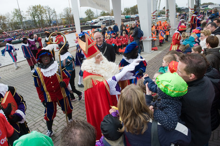 nicolaas: ENSCHEDE, THE NETHERLANDS - NOV 14, 2015: The dutch Santa Claus called Sinterklaas is greeting the children after he has arrived on a boat in a dutch harbor