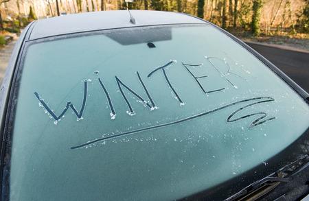 oversight: The word winter written on a frozen car windscreen