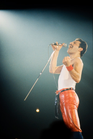 LEIDEN, THE NETHERLANDS - NOV 27, 1980: Freddy Mercury singer of british band Queen during a concert in the Groenoordhallen in Leiden in the Netherlands