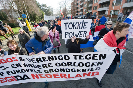 war refugee: ENSCHEDE, THE NETHERLANDS - FEB 13, 2016: People are demonstrating against a huge migrant refugee camp for muslim war refugees close to the part of the city where they live. Editorial