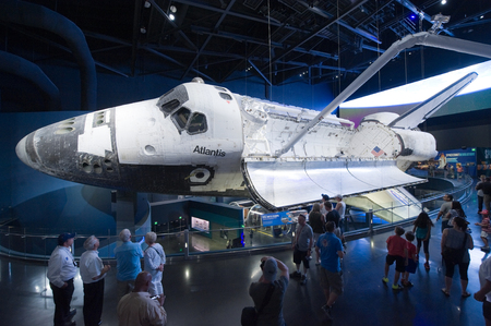 cape canaveral: KENNEDY SPACE CENTER, FLORIDA, USA - APRIL 27, 2016: Visitors looking at Space Shuttle Atlantis which is exhibited at the visitor complex of Kennedy Space Center