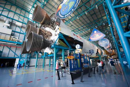 KENNEDY SPACE CENTER, FLORIDA, USA - APRIL 27, 2016: Visitors looking at the Saturn 5 rocket which is exhibited at the visitor complex of Kennedy Space Center