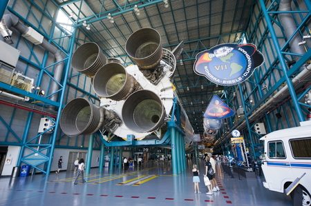 cape canaveral: KENNEDY SPACE CENTER, FLORIDA, USA - APRIL 27, 2016: Visitors looking at the Saturn 5 rocket which is exhibited at the visitor complex of Kennedy Space Center