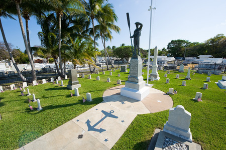 KEY WEST, FLORIDA, USA - MAY 02, 2016: Statue in the middle of the battleship Maine memorial section at Key West cemetery.