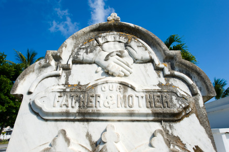 gravesite: KEY WEST, FLORIDA, USA - MAY 02, 2016: Gravestone at the Key West cemetery.  It is a 19-acres cemetery, and about 100.000 people are buried here.