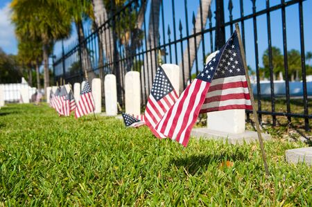KEY WEST, FLORIDA, USA - MAY 02, 2016: American flags on graves at the battleship Maine memorial section at the Key West cemetery. Editorial