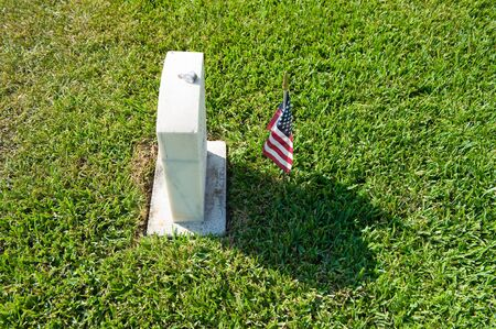 gravesite: KEY WEST, FLORIDA, USA - MAY 02, 2016: American flag on the grave at the battleship Maine memorial section at Key West cemetery. Editorial